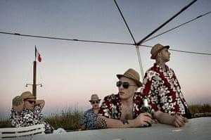 Weekend - Skinheads : Italian skinheads wearing hats and hawaiian shirts at party