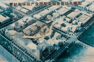 A torn poster showing the original plan for Caofeidian Environmental Industries Park. Government and state owned industrial enterprises are said to have invested 561 billion yuan (US $91bn) in the area over the past decade, but the park was never completed.