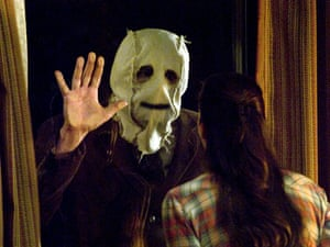 Liv Tyler meets the man in the mask in The Strangers.
