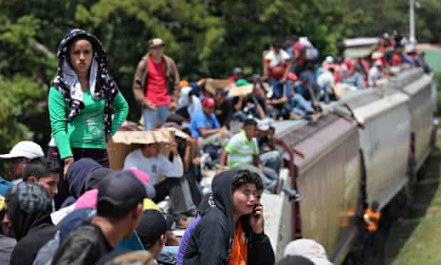 Migrants ride north on top of 'la bestia', heading for the US border.