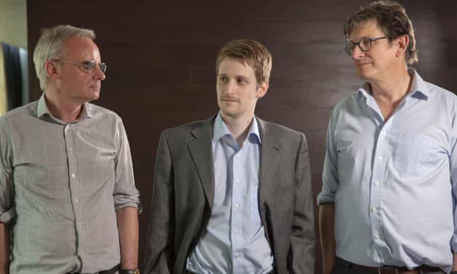 Edward Snowden is framed by Ewen MacAskill and Alan Rusbridger in Moscow. Photograph: Alex Healey
