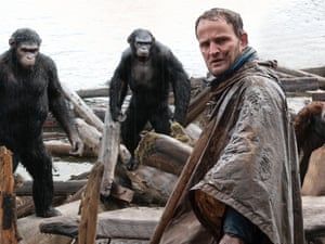 Jason Clarke, as Malcolm (foreground), and, background from left, Andy Serkis, as Caesar; Toby Kebbell, as Koba; and Karin Konoval, as Maurice; in a scene from Dawn of the Planet of the Apes.