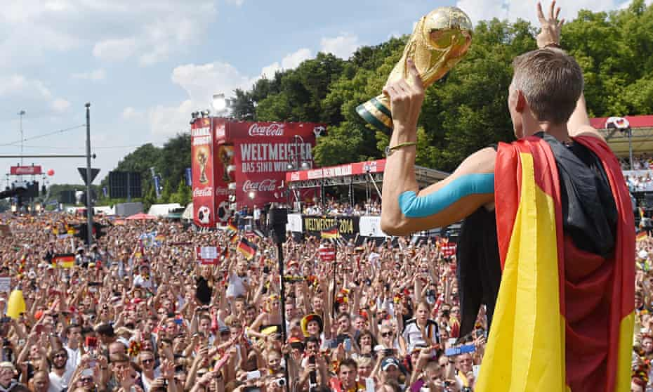Fans cheer midfielder Bastian Schweinsteiger in Berlin after Germany's World Cup triumph