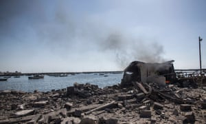 Smoke rises from a shed in the port of Gaza City where four young boys were killed. israel palestine