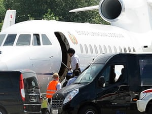 Bolivia's president Evo Morales, center, enters his plane after it was rerouted to Austria.