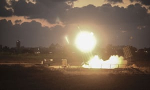 The Iron Dome air-defense system fires to intercept a rocket over the city of Ashdod.