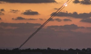 A picture taken from the Israel-Gaza border shows rockets being launched from Gaza.