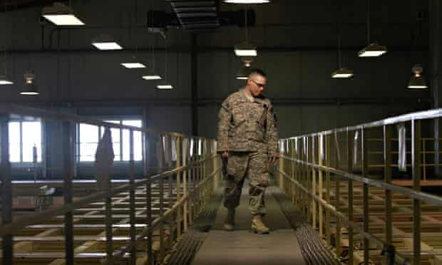 US military guard watches over detainee cells inside the Parwan detention facility in Afghanistan