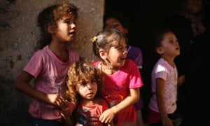 Relatives of four Palestinian children killed on a beach by Israeli bombardment mourn during the funeral in Gaza city.