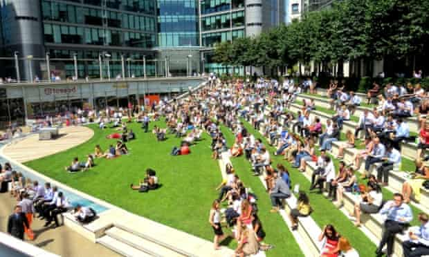 16 Jul 2014, London, England, UK --- London, United Kingdom. 16th July 2014 -- Office workers lunch outside in vast numbers in Paddington. -- The Met Office has issued a heatwave alert as temperatures soar to their highest of the year this weekend. The south-east could reach the low 30s Celsius (Mid-80s Farenheit) by Friday. --- Image by   brian minkoff/Demotix/Corbis British Isles City of Westminster England environment Europe Great Britain heat wave hot Inner London landscape London natural world office lunchtime Paddington paddington basin sun UK weather Western Europe webgalleryheatwave