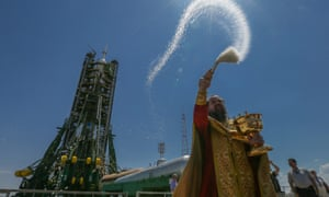 An Orthodox priest blesses the Russian Soyuz TMA-13M rocket booster on the launch pad at the Baikonur Cosmodrome, Kazakhstan, in May 2014.