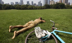 A New Yorker braves the scorching sun in Central Park