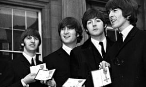 """""""The Beatles leaving Buckingham Palace in October 1965 after receiving their MBE's from the Queen"""""""