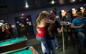 Jeremiah Constant, a drill equipment salesman originally from Colorado, flirts with Brittany Paige, originally from California at a bar in Williston.