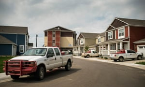 Trucks outside new homes rented by oil workers in Williston, North Dakota.