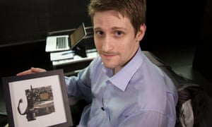 Edward Snowden with a fragment of the smashed laptop