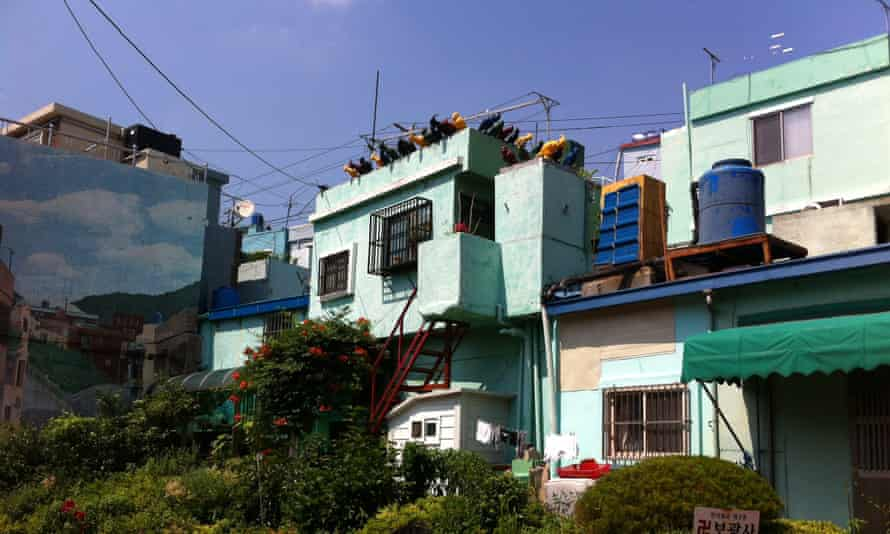 A building with a sky mural in Gamcheon, Busan.