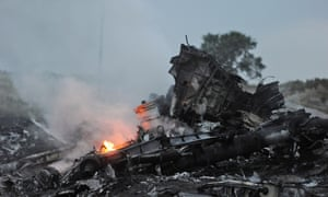 Flames amongst the wreckages of MH17. malaysia ukraine
