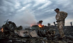 People walk among the debris of Malaysia Airlines flight MH17