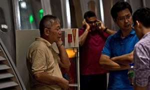 Relatives of passengers on Malaysia Airlines flight MH17 await information at Kuala Lumpur airport