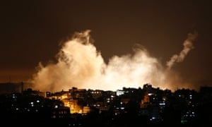 Smoke from flares rises in the sky in Gaza City