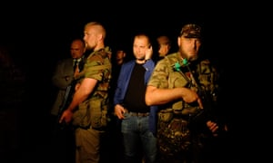 "Self-proclaimed Prime Minister of the pro-Russian separatist ""Donetsk People's Republic"" Alexander Borodai (C) stands as he arrives on the site of the crash of a malaysian airliner carrying 298 people from Amsterdam to Kuala Lumpur, near the town of Shaktarsk, in rebel-held east Ukraine."