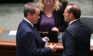 The Prime Minister Tony Abbott talks to the Opposition Leader Bill Shorten in the House of Representatives this morning after addressing the house on the Malaysian Airlines disaster, Friday 18th July 2014