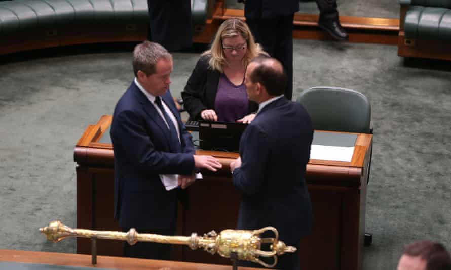 Tony Abbott talks to the opposition leader, Bill Shorten, in the House of Representatives on Friday morning.