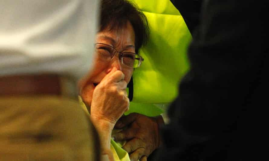 A Malaysian mother reacts after seeing her daughter's name on the list of passengers on board Malaysia Airlines MH17 when it was shot down over Ukraine with no survivors.