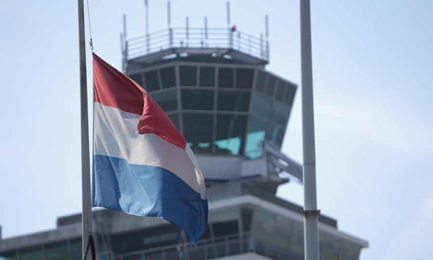 The Dutch flag flys at half-mast at Schiphol airport