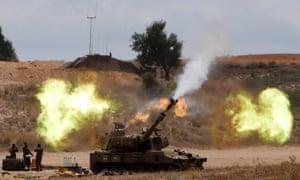 An Israeli mobile artillery unit fires towards the Gaza Strip.