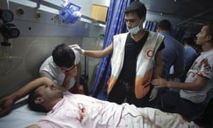 Wounded Palestinians in the emergency room of Shifa hospital in Gaza City, northern Gaza.