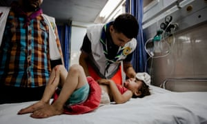 A young girl is being treated inside the emergency room in Shifa Hospital.