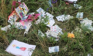 Belongings of passengers are scattered around the crash site.