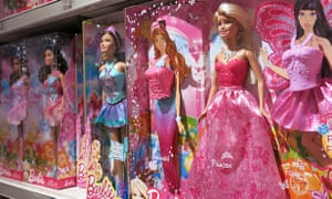 Barbie dolls line up in a shop in Times Square.