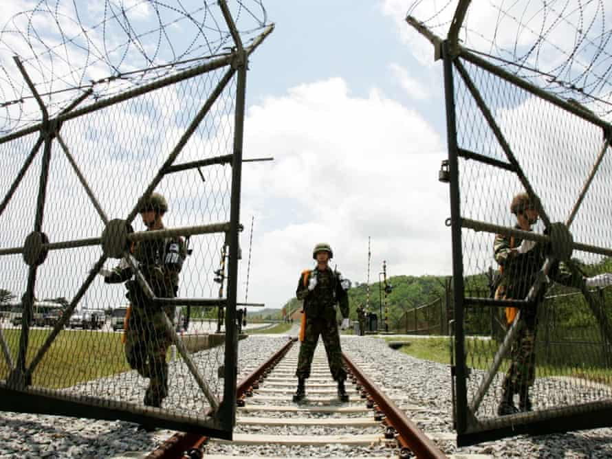 South Korean soldiers open the gate for the North Korea's train to pass near the demilitarized zone (DMZ) in 2007.