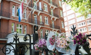 Tributes are left at the gates of the Dutch Embassy in London.