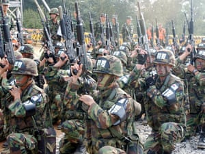 South Korean soldiers check their rifles before entering the mine-strewn Demilitarised Zone (DMZ) between the two Koreas in 2002.