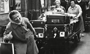 vintage picture of women pulling luggage cart