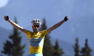 Italy's Vincenzo Nibali wearing the overall leader's yellow jersey celebrates as he crosses the finish line of stage 13.