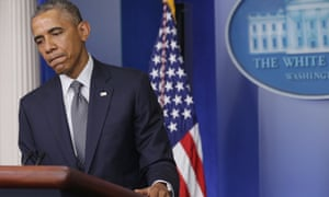 President Obama pauses while delivering a statement on the Malaysia Airlines crash.