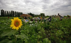 Miners scour fields looking for bodies and wreckage parts near the crash site. ukraine mh17