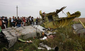 OSCE monitors and pro-Russian separatists stand at the crash site of Malaysia Airlines flight MH17.