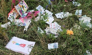 Passengers' belongings at the site of the Malaysia Airlines plane crash in east Ukraine