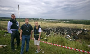 OSCE observers visit the crash site of a Malaysia Airlines MH17.