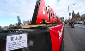 Flowers have been left by at a large sign on the Princes bridge in Melbourne for delegates who have been killed on flight MH17 who were traveling to the Aids 2014 conference