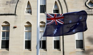 The Australian flag flies at half-mast and flowers have been laid at Kincoppal Catholic School in Rose Bay in memory of Sister Philomene Tiernan