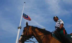 Malaysia's national flag is pictured flying at half-mast to mourn the passengers of Malaysian Airlines Flight MH17, at Independent Square in Kuala Lumpur