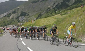 The pack with Italy's Vincenzo Nibali, wearing the overall leader's yellow jersey, right, climbs Lautaret pass.