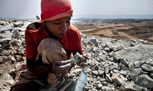 A villager searches for gold in discarded waste rock from Barrick Gold's north Mara mine in Tanzania